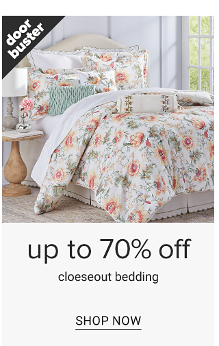 A bed made with a multi colored floral print quilt & matching pillows. Doorbuster. Up to 70% off closeout bedding. Shop now.