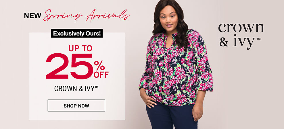 A woman in a colorful, floral top and solid pants. New Spring arrivals. Up to 25% off Crown & Ivy, exclusively at Belk. Shop now.