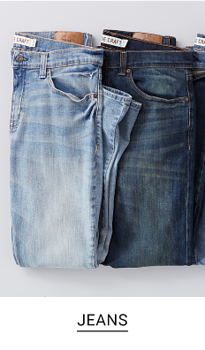 A pair of light and dark blue jeans. Shop jeans