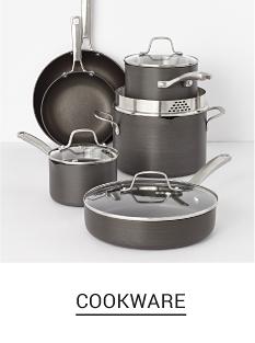 A set of gray non stick pots & pans with clear glass lids. Shop cookware.