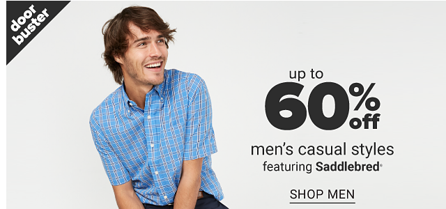 A man wearing a light blue & white plaid short sleeved button front shirt & navy pants. Doorbuster. Up to 60% off men's casual styles. Shop men.