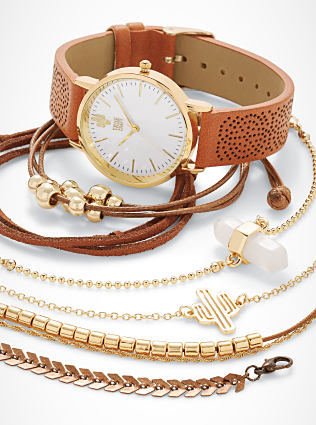 A woman's watch & an assortment of bracelets. Shop jewelry.