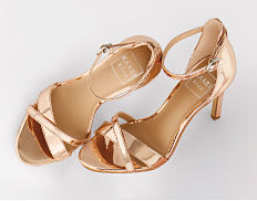 Gold strappy heels. Shop shoes.