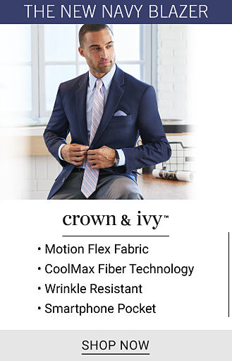 A man wearing a navy sport coat over a blue & white check dress shirt. Crown & Ivy. 4 way stretch fabric. Soil release fabric technology. Wrinkle resistant. 6 interior pockets. Shop now.