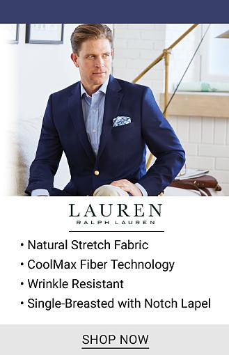 A man wearing a navy sport coat, a light blue dress shirt & beige pants. Lauren Ralph Lauren. Natural stretch fabric. Coolmax fiber technology. Single breasted with notch lapel. Shop now.