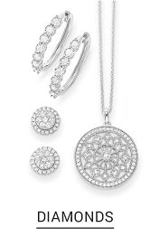 An assortment of silver jewelry with white diamonds. Shop diamonds.