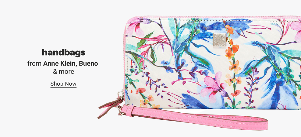 A white wallet purse featuring a tropical floral design with a light pink zipper and wrist strap. Handbags from Anne Klein, Bueno and more. Shop now.