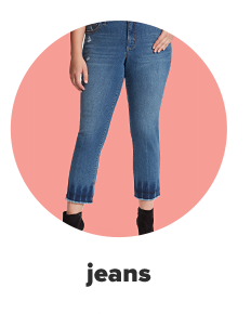A woman in jeans with black boots. Jeans.