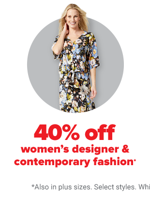 A woman in a floral maxi dress with elbow length sleeves. 40% off women's designer fashion.