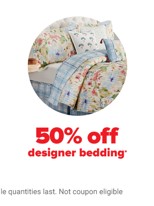 A reversible comforter set with one side floral and the other a blue checkered pattern. 50% off designer bedding.