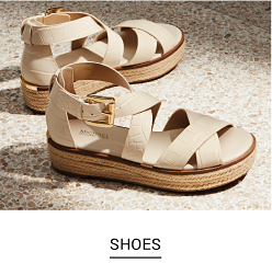 A pair of beige espadrille sandals. Shop shoes.