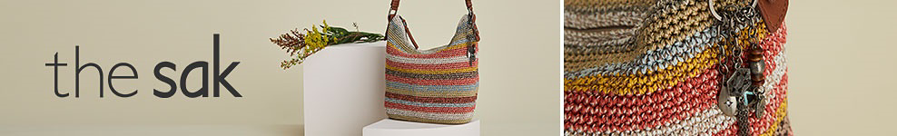 A straw handbag in red, blue, yellow and white stripes. The sak.