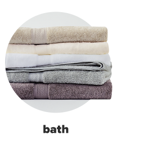 A stack of brightly colored towels in a variety of colors and designs Bath. Shop Now