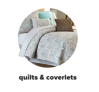 Ornate gray and blue bed set. Shop quilts and coverlets