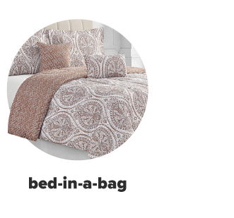 Rust orange and white patterned bedding. Shop bed-in-a-bag
