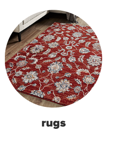 A red area rug with a gray floral print. Shop rugs