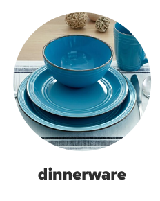 A table set with a variety of dinnerware and silverware. Shop dinnerware.