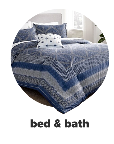 A blue and off white patterned bedding set with matching pillows and a small decorative pillow.