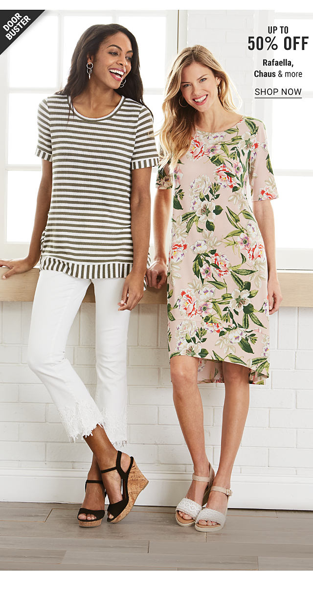 A woman wearing gray & white horizontal striped short sleeved top, white pants & black strappy wedge sandals standing next to a woman wearing a multi colored floral print short sleeved dress & beige sandals. Doorbuster. Up to 50% off Rafaella, Chaus & more. Shop now.