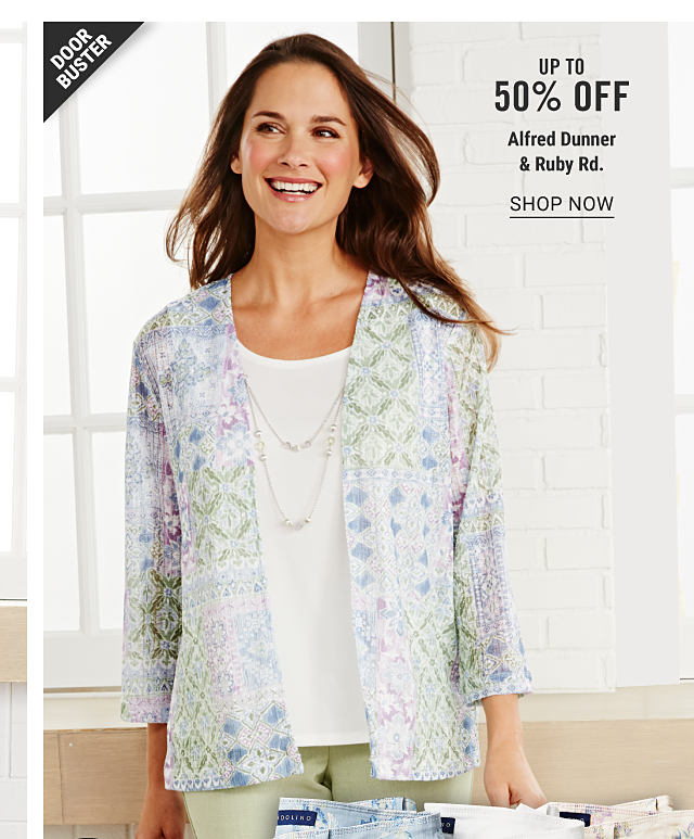 A woman wearing a multi colored patterned print jacket over a white top & beige pants. Doorbuster. Up to 50% off Alfred Dunner & Ruby Rd. Shop now.