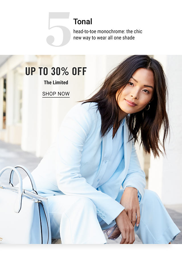 A woman wearing a white jacket, white blouse & white pants sitting next to a white leather handbag. Trend 5. Tonal. Head to toe monochrome. The chic new way to wear all one shade. Doorbuster. Up to 40% off The Limited. Shop now.