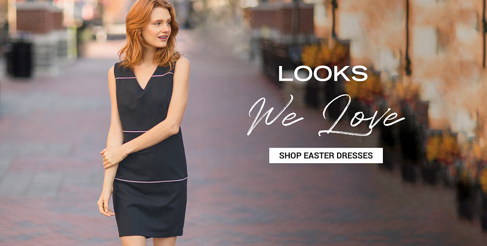 A woman wearing a short navy sleeveless dress with a V neckline. Easter Looks We Love. Shop Dresses.