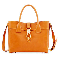 A brown leather tote with gold hardware detail. Shop Florentine collection.