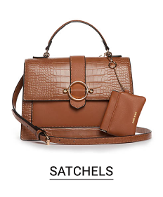 A brown leather satchel and matching wallet. Shop satchels.
