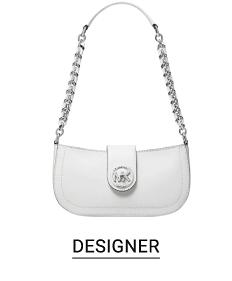 A small white handbag with a silver chain strap. Shop designer.