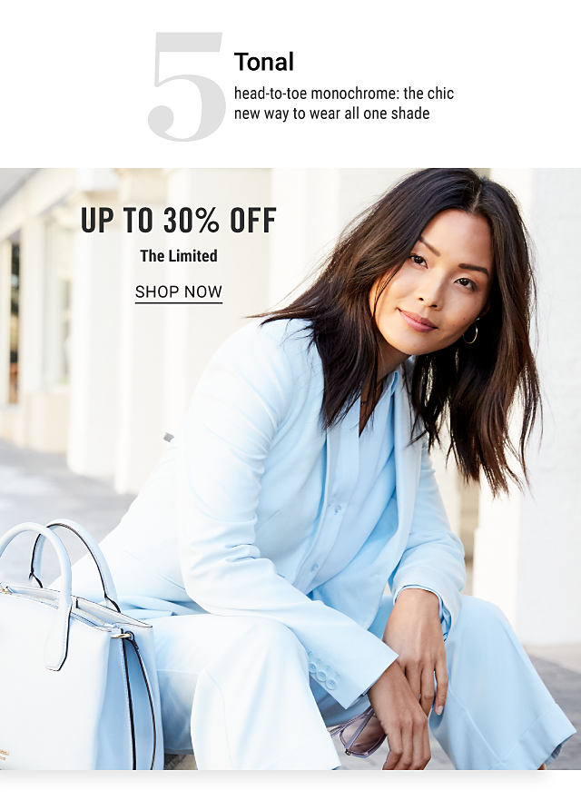A woman wearing a white jacket, white blouse & white pants sitting next to a white leather handbag. Trend 5. Tonal. Head to toe monochrome. The chic new way to wear all one shade.. Up to 30% off The Limited. Shop now.