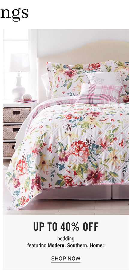 A bed made with a multi colored floral print comforter & matching pillows. Up to 40% off bedding featuring Modern Southern Home. Shop now.