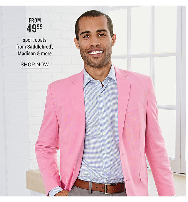 A man wearing a light pink sport coats, a light blue & white check dress shirt & gray pants. From $49.99 sport coats from Saddlebred, Madison & more. Shop now.