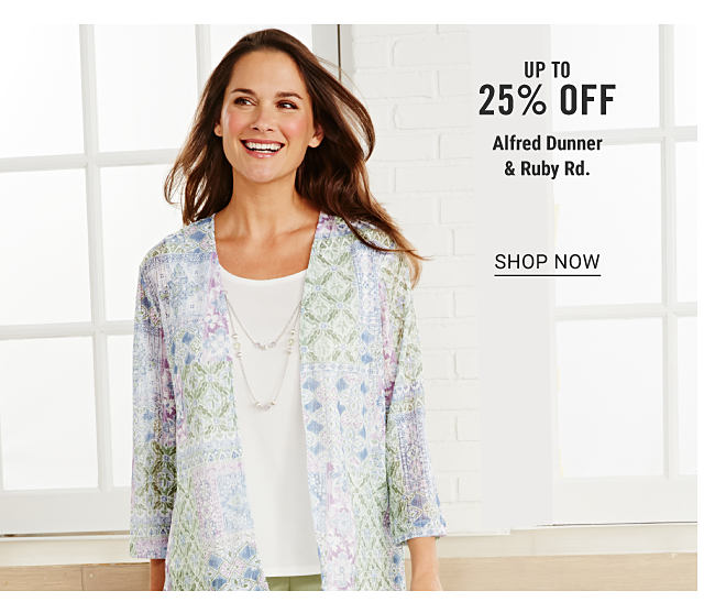 A woman wearing a multi colored patterned print jacket over a white top & beige pants. Up to 25% off Alfred Dunner & Ruby Rd. Shop now.