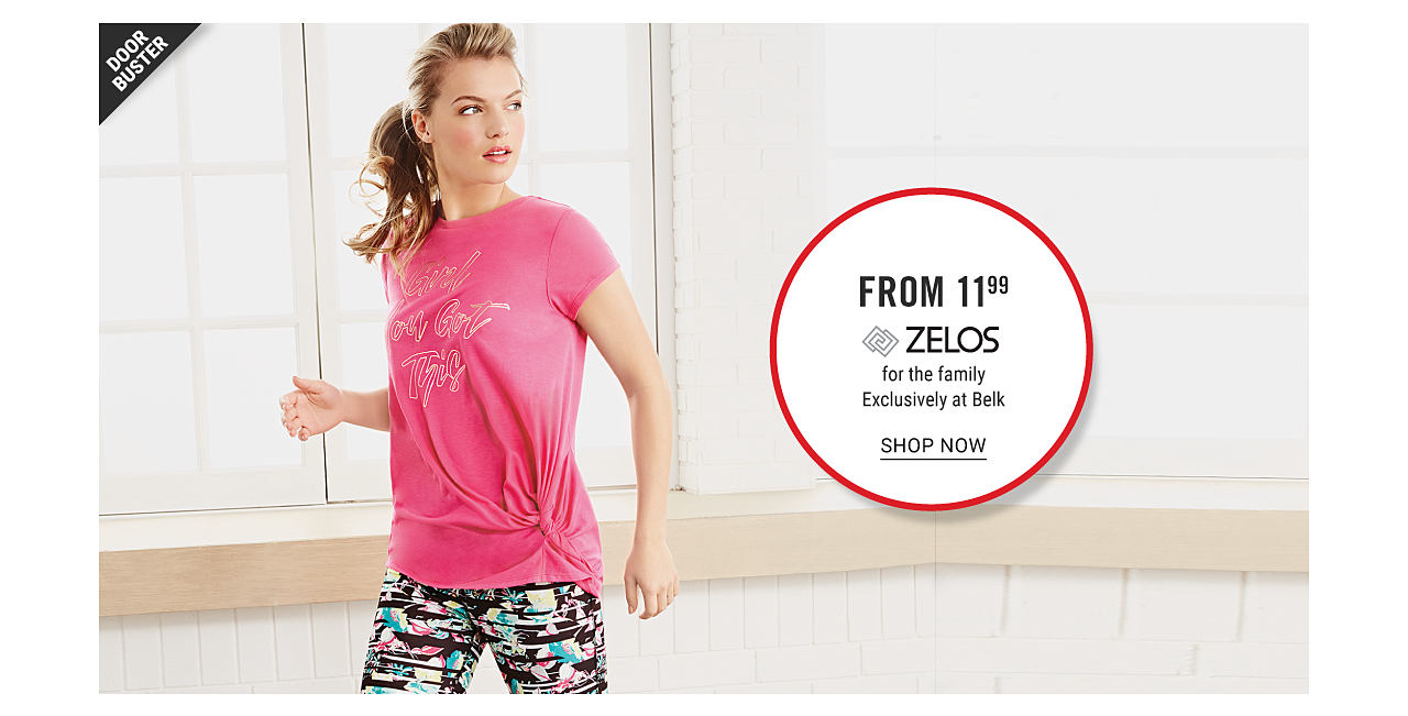 A woman wearing a pink tee with a gold front graphic & multi colored print yoga pants. Doorbuster. From $11.99 Zelos for the family. Exclusively at Belk. Shop now.