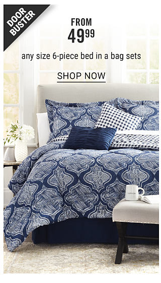 A bed made with a navy & white patterned print comforter & matching pillows. Doorbuster. From $49.99 any size 6 piece bed in a bag sets. Shop now.
