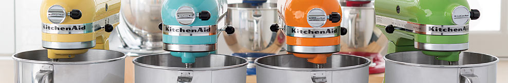 A yellow KitchenAid mixer, a teal KitchenAid mixer, an orange KitchenAid mixer & a green KitchenAid mixer. Easily make your favoriet cakes, and multiples batches of cookie dough with the KitchenAid Tile Head stand mixer & glass mixing bowl. With 10 speeds, it will quickly become your kitchen's culinary center as you mix, knead & whip ingredients with ease.