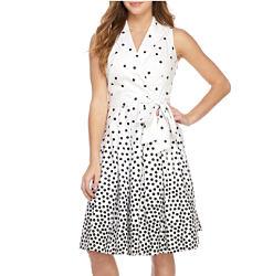 A woman wearing a black & white sleeveless dress. Shop women.