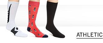 A man wearing white & black athetic socks. Shop athletic socks