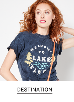 A young woman in a gray Lake Tahoe graphic tee. Shop destination.