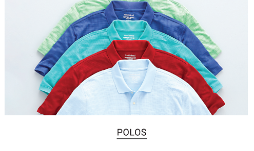 An assortment of polos in a variety of colors. Shop polos
