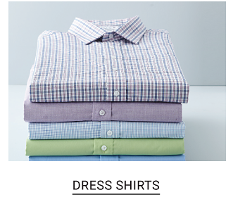 A stack of dress shirts in a variety of prints and colors. Shop dress shirts.
