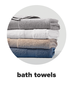 A stack of four towels in grey, white, beige and blue. Bath towels