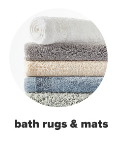 A stack of five bath mats in white, grey, off white, light blue and light green. Bath rugs and mats.