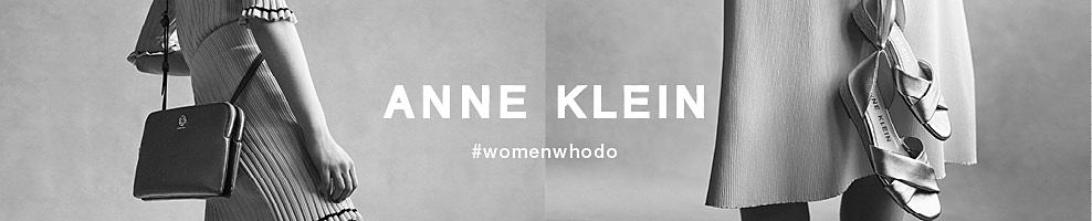 A black & white picture of a woman wearing s dress & carrying a purse & a woman wearing a dress carrying shoes. Anne Klein. Hashtag women who do.