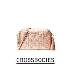 A textured beige leather crossbody handbag. Shop crssobodies.