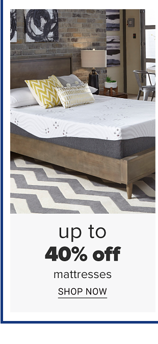 A white and grey mattress with an assortment of throw pillows. Doorbuster. Up to 40 percent off mattresses. Shop now.