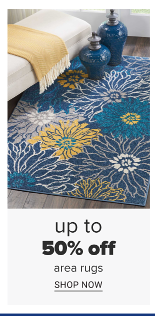 A blue area rug with yellow, teal and white floral designs. Doorbuster. Up to 50 percent off area rugs. Shop now.