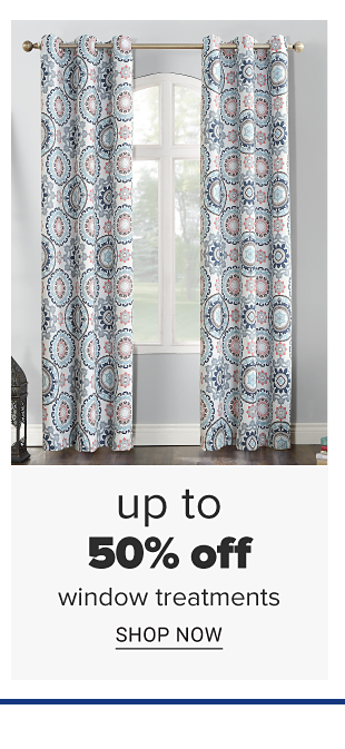 A white, blue and purple window curtain with circular and mandala designs. Doorbuster. Up to 50 percent off window treatments. Shop now.