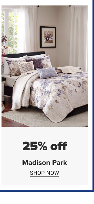 A bed made up with a white comforter with purple floral designs and matching pillows. Doorbuster. Up to 25 percent Madison Park. Shop now.