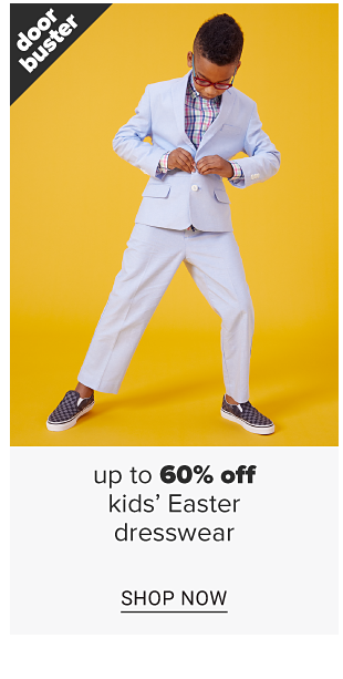 A little boy in a pale blue suit, a colorful button down shirt and black and grey checkered slip-on sneakers. Doorbuster. Up to 60 percent off kids easter dresswear. Shop now.